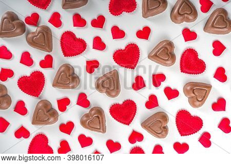 Red And Chocolate Hearts Background