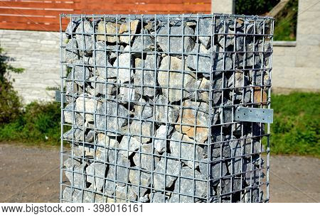 Gabion Fence Post, Basket Filled And Straightened With Stone Into A Visible Form