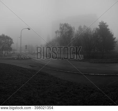 Chomutov, Czech Republic - November 27, 2020, 15:17 - Path Leading To Experimenty Houses In Foggy Au
