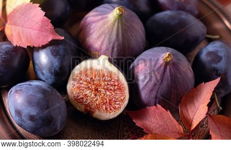 Ripe Plums And Figs On A Platter. Nice Photo Of Food. Banner.