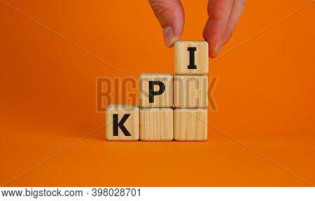 Kpi Symbol. Wood Cubes With Acronym 'kpi, Key Performance Indicator' Stacking As Step Stair On Orang