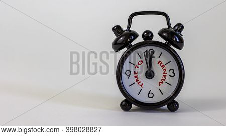 Time To Renew Concept. Beautiful Black Alarm Clock With Words 'time To Renew'. White Table. Beautifu