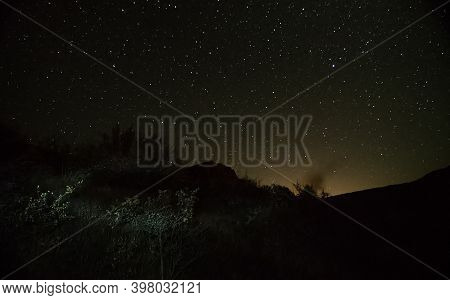 Starry Sky Over The Mountains. A View Of The Night Sky In Autumn.