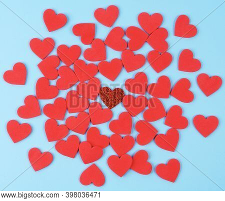 A Texture Formed With Small Red Hearts On A Blue Background