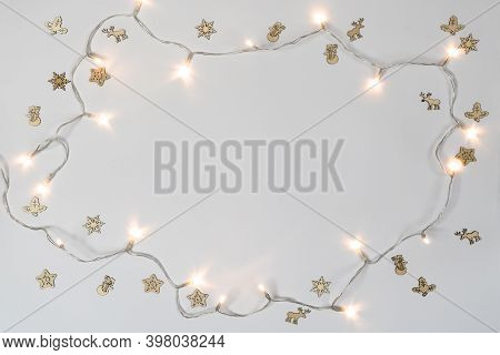 Some Small Decorative Icons And Holiday Lights On A  White Background