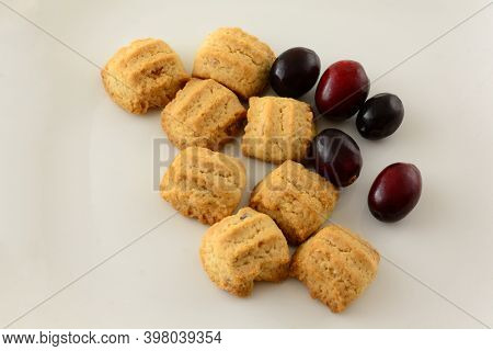 Crunchy Cranberries Cookies With Fresh Raw Cranberries On White Plate Background