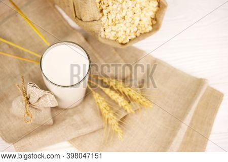 Vegan Non Dairy Alternative Milk On Wooden Table
