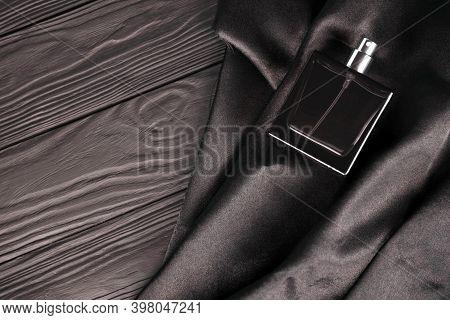 Male Scent Perfume Bottle On Dark Silk Background