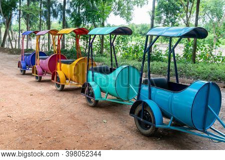 Colorful Car Carts With Roof Top Ready To Use For Traveling Around Park.