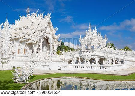 Chiang Ray, Thailand - December 16, 2018: Near The Futuristic Buddhist Temple Wat Rong Khun (white T