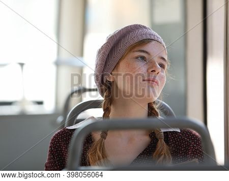 Portrait Of A Freckled Teenage Girl With Pigtails Dressed In Retro Style Clothes In A Wagon Of A Dri