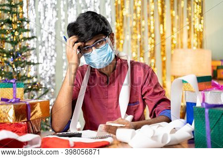 Young Man In Face Mask Worried About Holyday Expenses After Christmas Or New Year 2021 Holiday Celeb