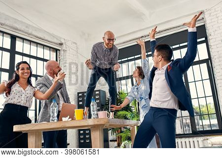 Excited Diverse Business Team Employees Screaming Celebrating Good News Business Win Corporate Succe