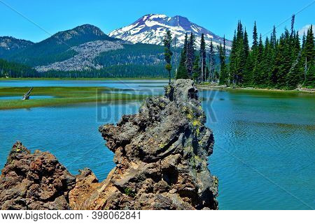 Lava Rock Panorama - A View From The Volcanic Rock Formation At Sparks Lake - South Sister Peak In T
