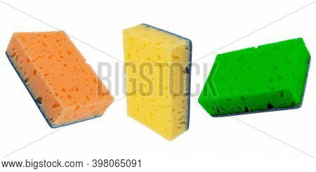 Macro Shot Of A Surface Of Plastic Multicolored Three Sponge Isolated On White Background. Close-up
