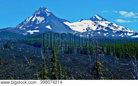 Sisters Backside - A View Of North And Middle Sister Peaks As Seen From Mckenzie Pass - Cascade Rang