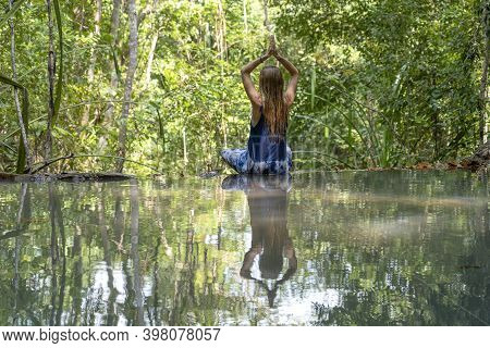 Beautiful Woman Practicing Yoga Near Forest Lake. Young Woman Near Turquoise Water Of Cascade Waterf