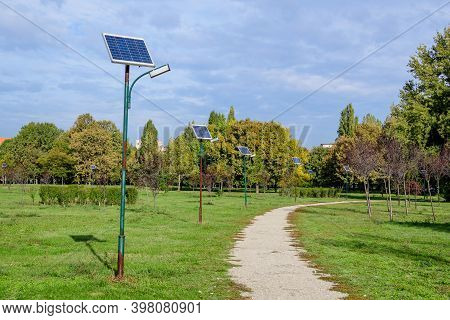 Long Alley And Many Lighting Poles Activated With Attached Blue Solar Panels In Parcul Izvor (izvor
