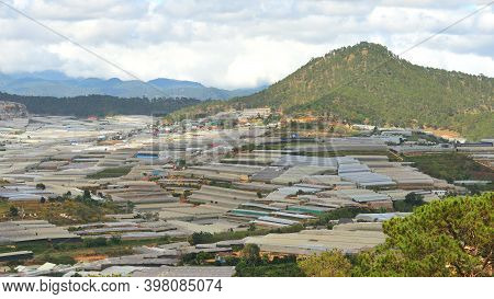 City Landscape With Big Mountain In  Bird Eye View At Dalat City.
