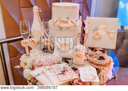 Wedding Accessories, Invitation, Box, Glasses, Champagne, Candles, Brides Garter Lying On The Table.