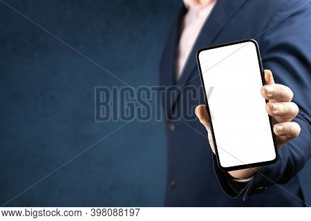 Mockup Phone. Businessman Shows Cell Phone With Blank Screen. Man In Suit Holds Mobile Phone With Bl