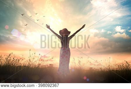 Praise And Worship God Concept: Silhouette Of Healthy Woman Raised Hands For Praise And Worship God