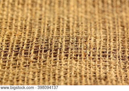 Sackcloth Burlap Woven Texture Background,. Burlap Background And Texture With Interesting Light.