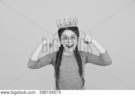 Think Cool. Cool Child Point At Crown On Head. Happy Beauty Queen Yellow Background. Fashion Accesso