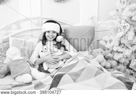We Gonna Sleep Together. Happy Child Cuddle Toys In Bed. Childhood Happiness. Enjoying Happy Childho