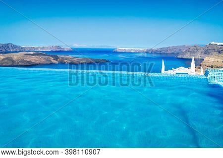 Clear Pool Water And View Of Santorini Caldera, Greece, Toned
