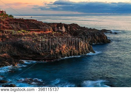 Scenic rocky coastline scenery on sunset. Tenerife, Canary Islands, Spain
