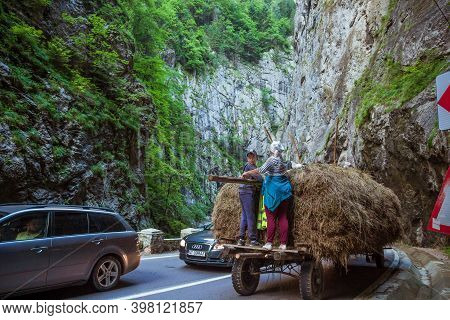 Bicaz Gorges, Romania - August, 2019 : Hay Wagon Going Through Bicaz Canyon In Romania. Bicaz Key Is