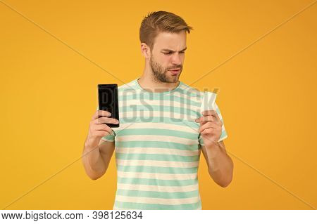 Shopping Discount Card. Handsome Guy Hold Card And Phone. Gift Card Or Voucher. Cash Coupon. Mobile