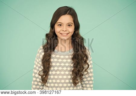 Little Girl Blue Background. Smiling Small Girl With Long Hair. Beauty And Health. Childhood And Gir