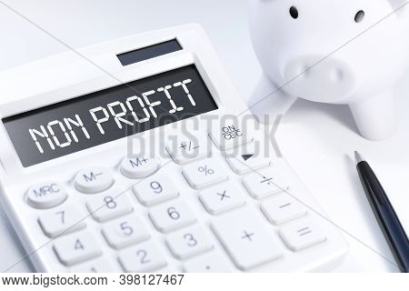 Word Non Profit On Calculator. Business And Tax Concept On White Background. Top View.