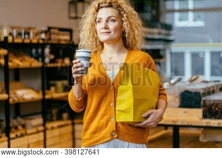 Zero Waste Concept. Shopping Bag, Blond Woman Holds Reusable Cup, Paper Bag With Fresh Food. Curly G