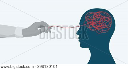 Mental Health Concept.hand Of A Therapist Or Doctor Untangling A Tangle In The Silhouette Head Of A