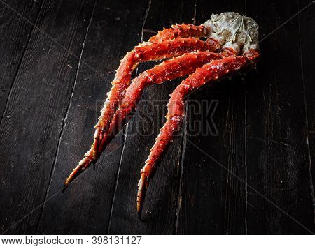 Fresh Red King Crab Crab Claws On Vintage Wooden Background. Tasty Kamchatka Crabs Claw