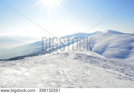 Winter Mountain Landscape With Sun. Great Place For Winter Sports. Beautiful Winter Landscape.
