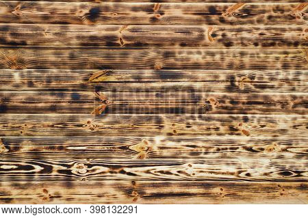 Texture Of Burnt Wooden Boards. Burnt Brown Wood Planks. Wood Texture.