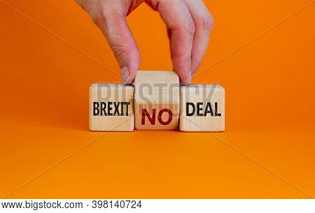 Brexit No Deal Symbol. Hand Turns A Cube And Changes The Words 'brexit No Deal' To 'brexit Deal'. Be