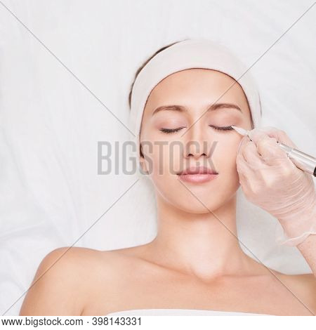 Permanent Makeup. Beauty Spa Procedure. Beauty Young Woman. High Quality Photo. Eye Tattoo. Eyeliner