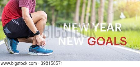 New Year New Goals With Young Man Tying Shoelace In The Park Outdoor, Athlete Runner Man Ready For R