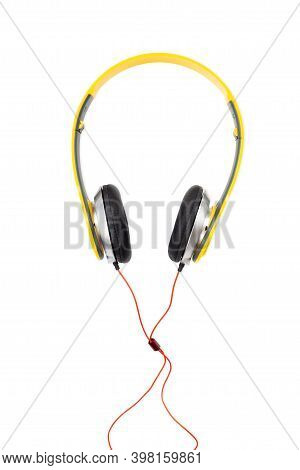 Yellow Headphones Isolated On White Background With Clipping Path. Top View.