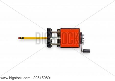 Red Mechanical Pencil Sharpener With Yellow Pencil Isolated On A White Background. Top View.