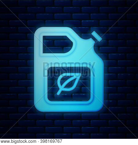 Glowing Neon Bio Fuel Canister Icon Isolated On Brick Wall Background. Eco Bio And Barrel. Green Env
