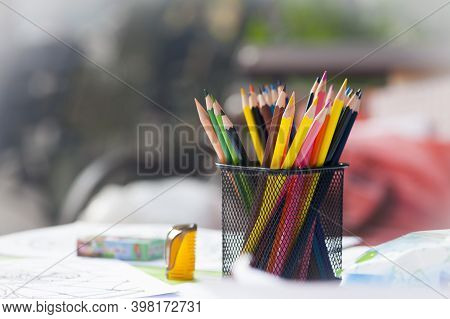 Multicolored Pencils In The Office. Drawer For Pens And Pencils. Colored Pencils In A Pencil Case. C
