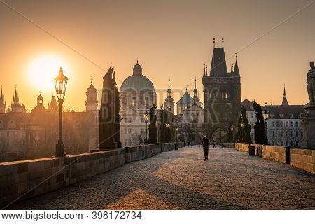 Prague, Czech Republic, April 2020 - Man In Respirator During Covid Lockdown, Charles Bridge At Sunr