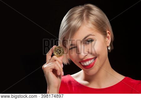 Woman Holding Physical Bitcoin Cryptocurrency Coins In Her Hands