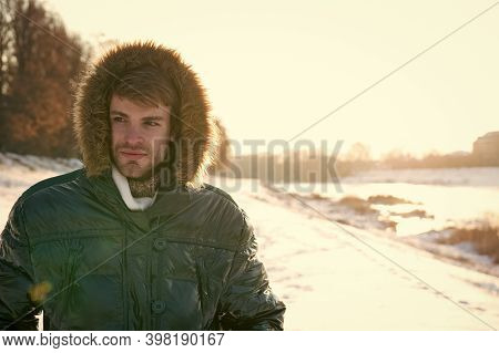 Winter Outfit. Hipster Fashion Outfit. Guy Jacket Hood. Man Warm Jacket Snowy Nature Background. Win